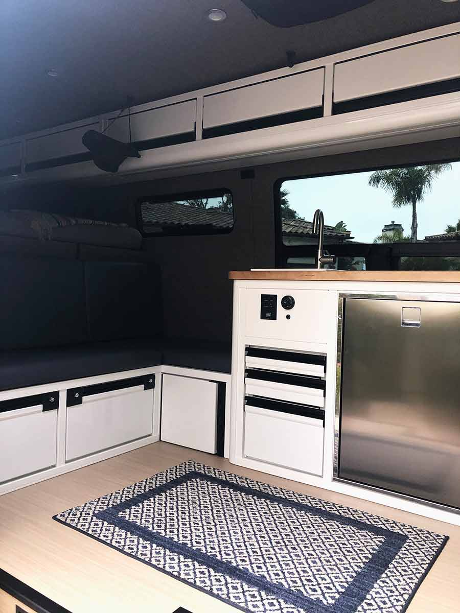 TouRig Airliner Cabinets, one of our favorite features of our Sprinter van