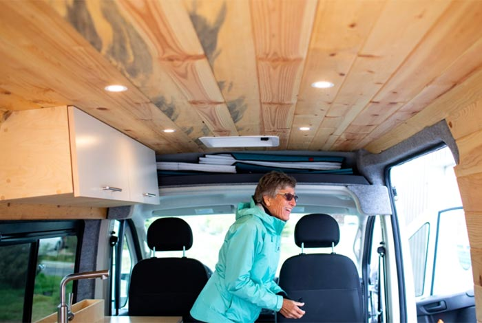 woman in her newly converted van travels around the country